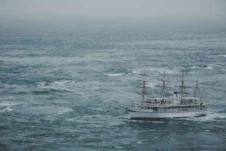 A ship that crosses the sea through a maelstrom
