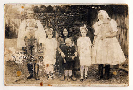 Just merried couple, bridesmaids, nephew and grandmother. Taken in Slovak village (Central Europe) in 1920. Without image restoration. photo