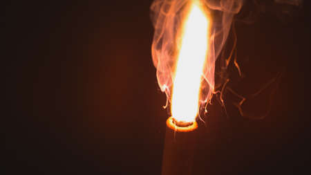 Fiery flame at end of wooden stick Stok Fotoğraf