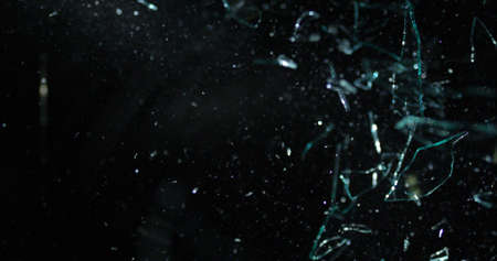 Large glass shards on right side over black background