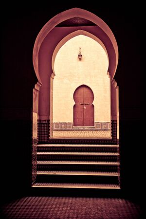 entries: Puerta , behind a courtyard and several entries with Arab forms