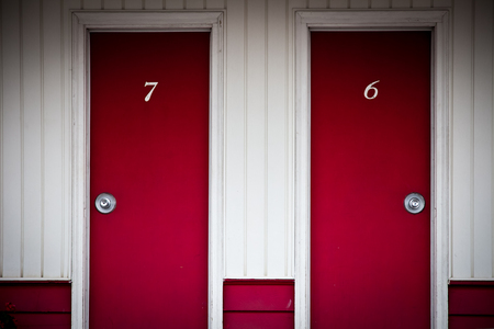number six: Two red door corresponding to two rooms at a roadside motel