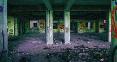 vandal: View of one of the long corridors of an abandoned hospital details of all graffiti Stock Photo