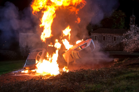 overturn: Explosion controlled two vehicles during the filming of a movie Stock Photo
