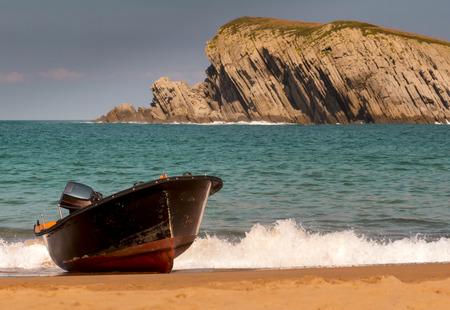 cantabria: Small boat on the beach of La Arnia, Cantabria, Spain Stock Photo