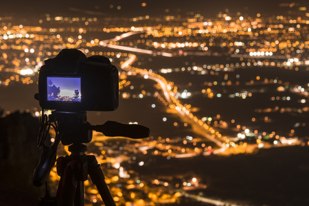 nocturnal: Camara photographing a nocturnal city, long exposure