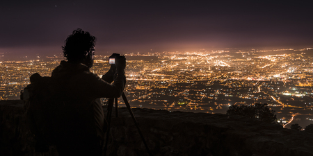Photographer, photographing Murcia at night.Spain.