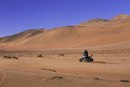 quad: Quad in competition by the desert sands