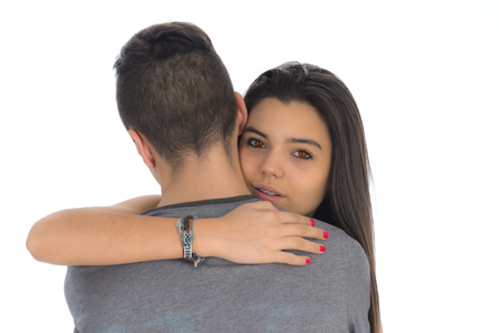 couple in love: Teenager woman embracing for the first time the boy she likes Stock Photo