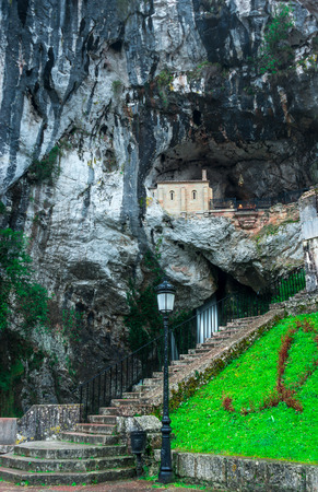 northern spain: View of Santa Cueva de Covadonga, with its waterfall
