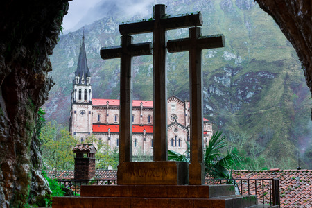 covadonga: Cross inside the Holy Cave of Covadonga, in the background the Basilica of Covadonga
