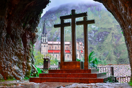 northern spain: Cross inside the Holy Cave of Covadonga, in the background the Basilica of Covadonga
