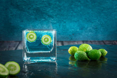 immersed: Two small limes immersed in an effervescent liquid Stock Photo