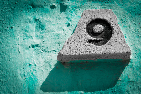 impressed: number nine engraved on a stone Stock Photo