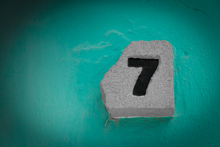 number seven engraved on a stone
