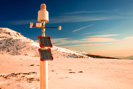 communications tools: Weather station, powered with solar panels in high mountain Stock Photo