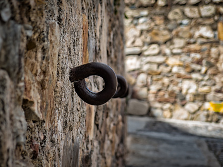 Metal ring embedded in the wall, possibly for some use during the Middle Ages Stock Photo