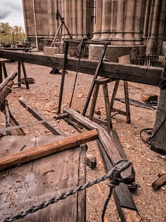 sawmill: Old tools of a artisan sawmill : saw, ropes, wood. Stock Photo