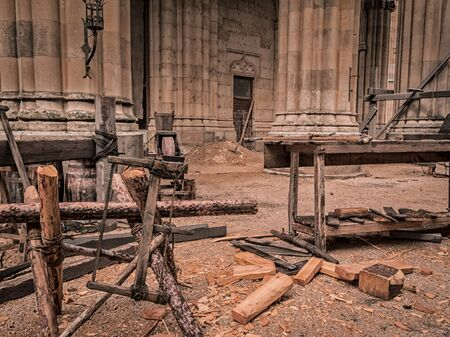 lumber mill: Old tools of a artisan sawmill : saw, ropes, wood. Stock Photo