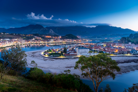 Panoramic night view of the city of Ribadesella.Asturias, Spain. Stock Photo