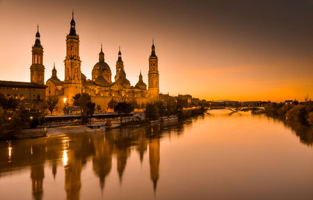 View of the basilica of Our Lady of Pilar at sunset Фото со стока