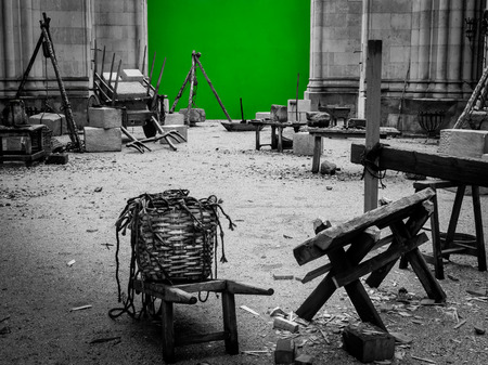 Set of filming, various objects to create a medieval atmosphere during a shoot.Green screen
