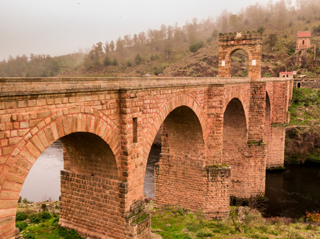 Fog day in the Roman Bridge of Alcantara.Caceres.Spain. Stock Photo