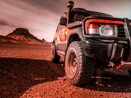 Across the desert in a 4x4 vehicle, prepared with rescue accessories