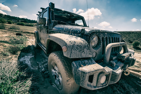 Robust appearance of an off-road vehicle, covered in mud.
