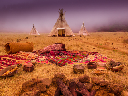 Teepees tent camp, home of the ancient Native Americans Stock Photo