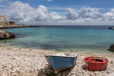 levanzo: red and ble boats on a italian islad Stock Photo