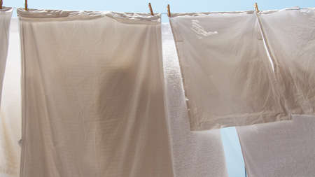 bedclothes: pillowcases and towels hanging out to dry