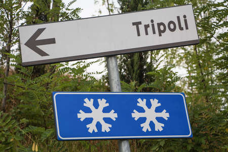 improbable: a road sign warns that  there may be snow in Tripoli