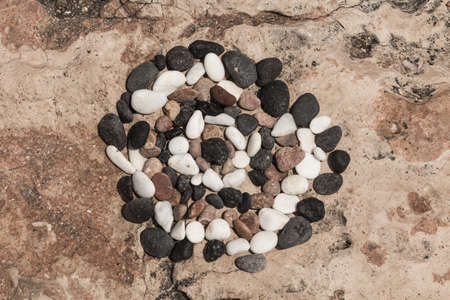 grasp: dartboard made by stones on the rocks Stock Photo