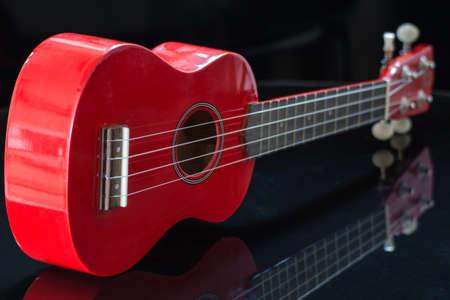 soprano: soprano red ukulele body and keyboard Stock Photo