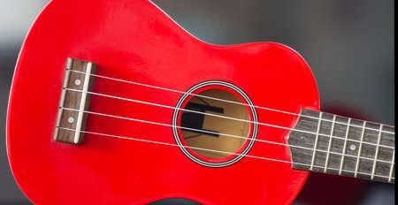 nylon string: Soprano ukulele red body and keyboard