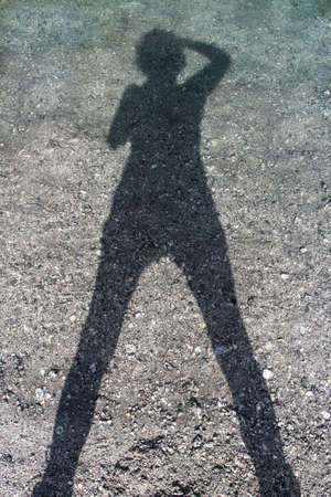 woman shadow: woman photographing his own shadow in the torrent