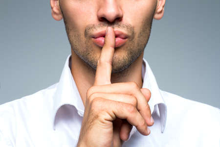 Biznesmen cichy cichy gest z palcem Zdjęcie Seryjne