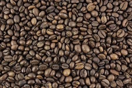 energizing: Coffee beans background Stock Photo