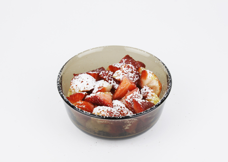powdered: Sliced strawberries with powdered sugar Stock Photo
