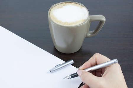 break in: Hand signing a document in a coffee break