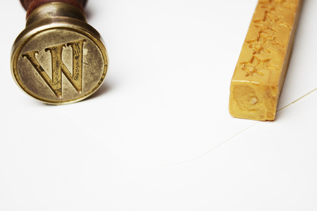 initial cap: W letter stamp and wax Stock Photo