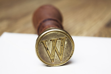 initial cap: W letter stamp Stock Photo