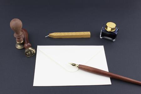 ink pot: Pen, stamp, envelope, ink pot and wax