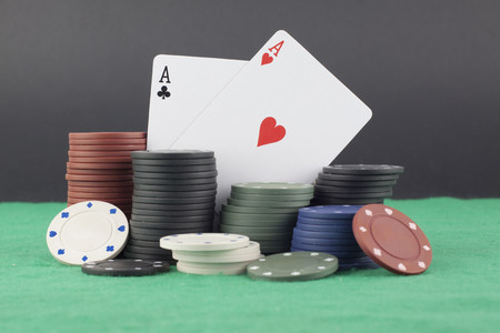 chips stack: Stack of poker chips and aces