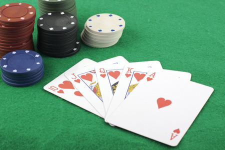 Straight flush and poker chips Stock Photo