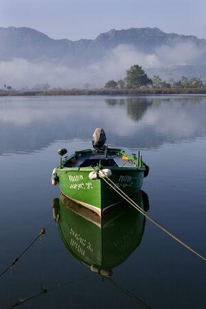 Small fishing boats moored in calm water at Ribadesella, Asturias, North Spain, Europe. photo