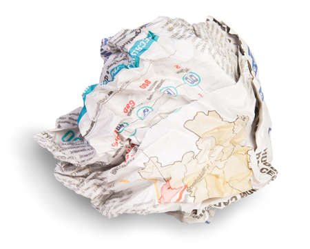Crumpled Sheet Of Newspaper Isolated On White Background photo