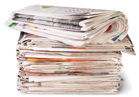 Stack Of Newspapers And The Roll Isolater On White Background photo