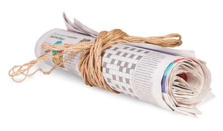 Roll Of Newspapers Tied With A Rope Isoleted on White Background photo
